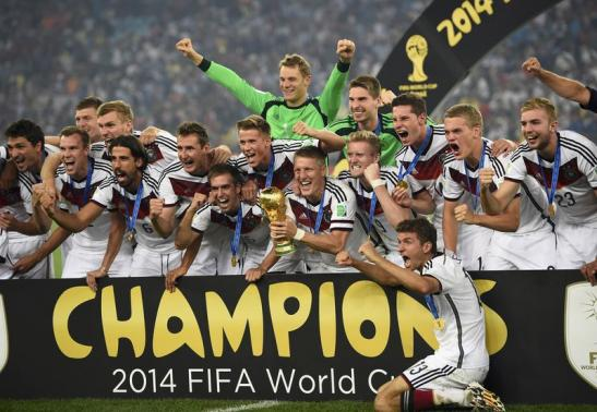 Germany's Schweinsteiger holds the World Cup trophy after winning the 2014 World Cup against Argentina in Rio de Janeiro