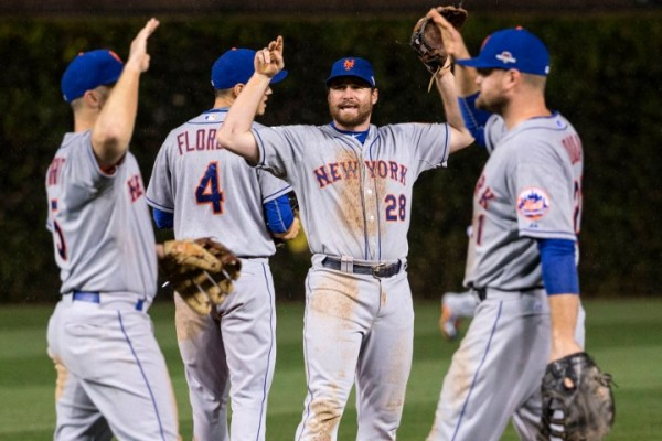 Chicago, IL - October 20: Daniel Murphy #28 of the New York Mets celebrates with David Wright and Lucas Duda after winning game three of the NLCS against the Chicago Cubs at CitiField. October 20, 2015. (Photo by Anthony Causi)