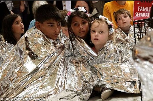 trump mexican children wrapped in foil blankets